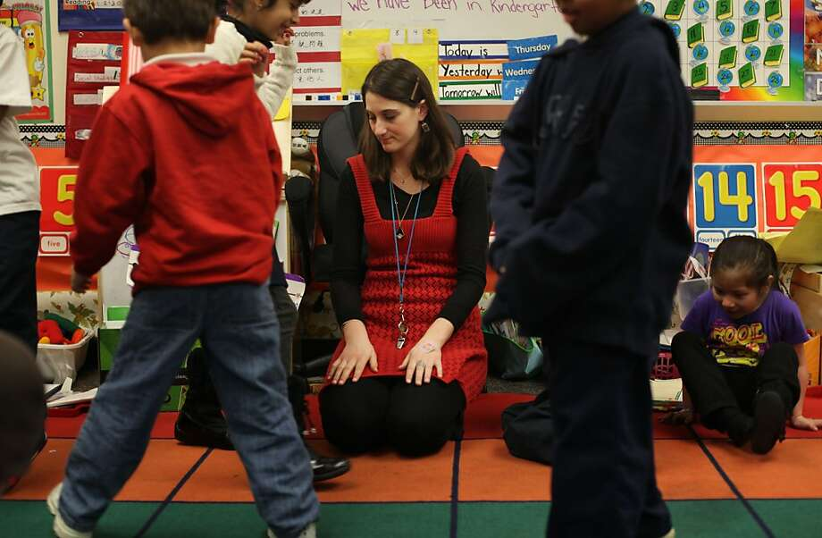 "Garfield Elementary kindergarten teacher, Marian Marx works with her students on Friday January 20, 2012 in Oakland, Calif. Marx took the job at Garfield after her position and four others in the district were eliminated due to class consolidation on day 40 of the fall session. She won the position she said largely because of seniority but said the process was not good for either the student or the displaced teachers. ""It didn't work out for everyone,"" she said. Photo: Mike Kepka, The Chronicle"