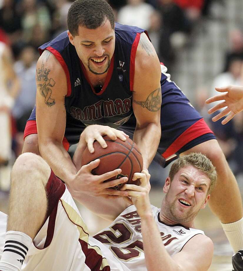 Santa Clara forward John McArthur (25) battles for a loose ball against St. Mary's forward Rob Jones (22) during the first half of an NCAA college basketball game on Saturday, Jan. 21, 2012, in Santa Clara, Calif. (AP Photo/ Tony Avelar) Photo: Tony Avelar, Associated Press