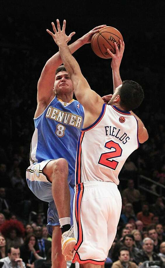 Denver Nuggets' Danilo Gallinari (8), of Italy, shoots over New York Knicks' Landry Fields (2) during the second overtime period of an NBA basketball game Saturday, Jan. 21, 2012, in New York. Gallinari scored 37 points as the Nuggets won the game 119-114. (AP Photo/Frank Franklin II) Photo: Frank Franklin II, Associated Press