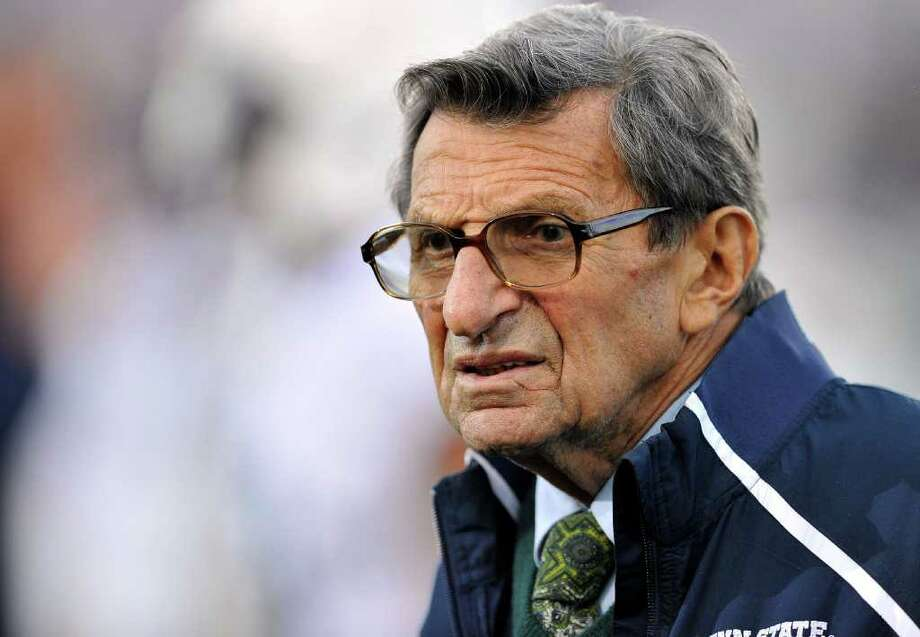 "FILE - In this Oct. 22, 2011 file photo, Penn State coach Joe Paterno stands on the field before his team's NCAA college football game against Northwestern, in Evanston, Ill. Paterno's doctors say that the former Penn State coach's condition has become ""serious,"" following complications from lung cancer in recent days. (AP Photo/Jim Prisching, File) Photo: Jim Prisching / AP2011"