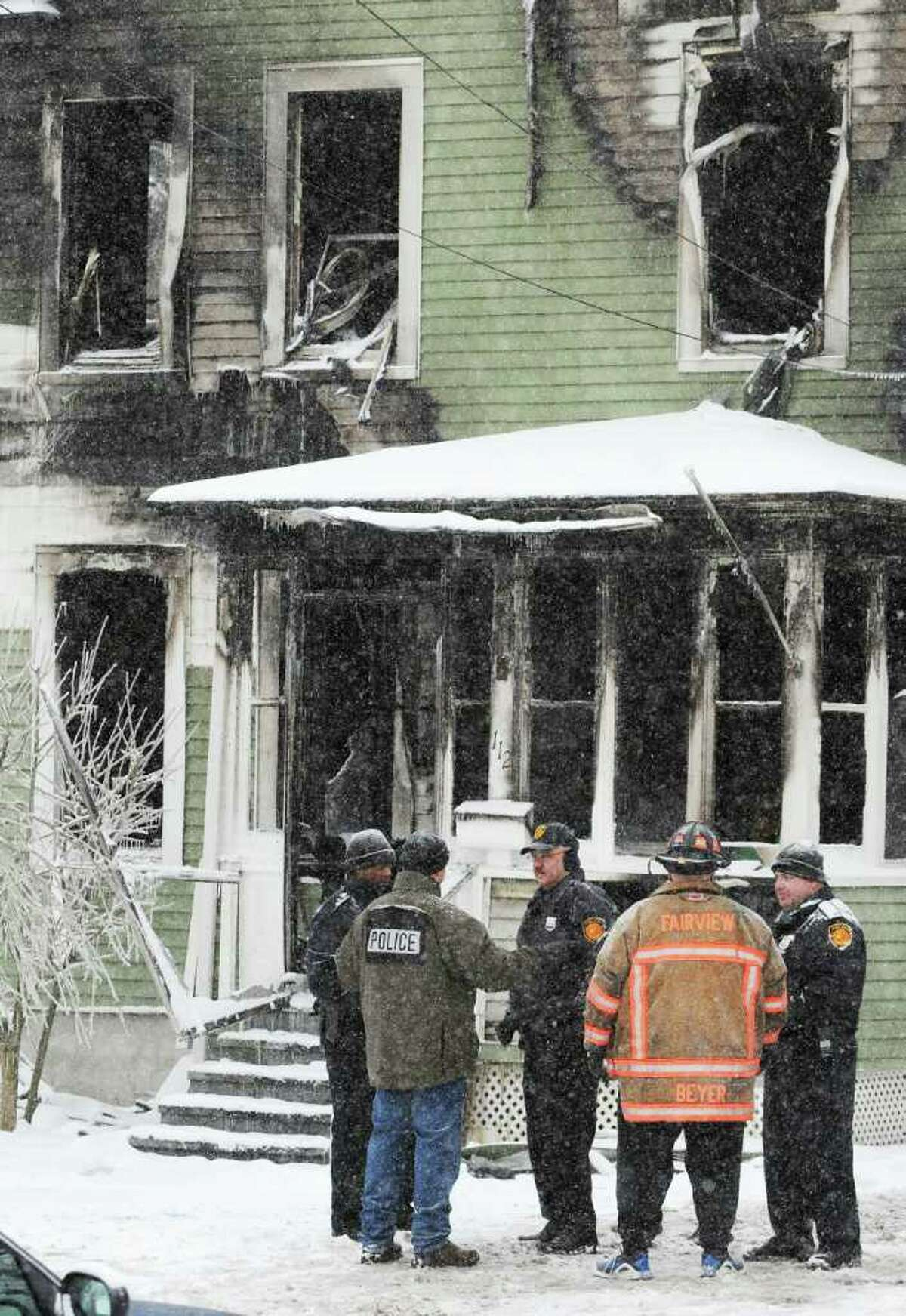 Town of Poughkeepsie and the Fairview Fire Department with other authorities at 112 Fairview Ave. in the Town of Poughkeepsie on Saturday, Jan. 21, 2012. A fire destroyed the building. (AP Photo/Poughkeepsie Journal, Darryl Bautista)