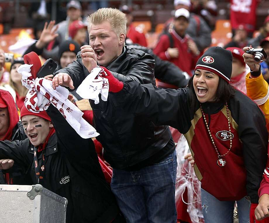 Fans cheer as their favorite 49ers players warm up before the NFC Championship game against the New York Giants at Candlestick Park in San Francisco, Calif. on Sunday, Jan. 22, 2012. Photo: Paul Chinn, The Chronicle