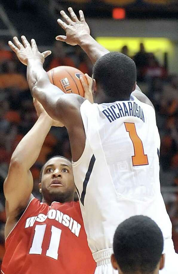 Wisconsin guard Jordan Taylor (11) shoots over Illinois' D.J. Richardson on Sunday. Photo: AP