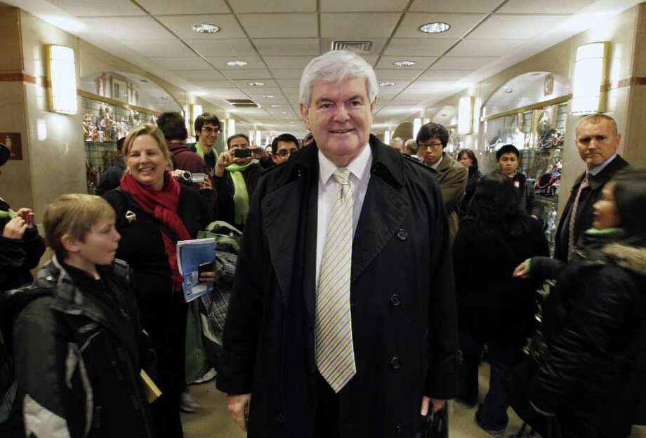 Republican presidential candidate and former House Speaker Newt Gingrich is greeted by supporters after Mass at the Basilica of the National Shrine in Washington Sunday,  Jan. 22, 2012. Photo: AP