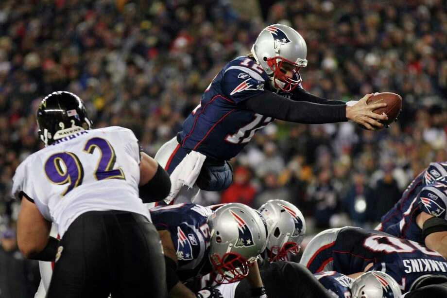 FOXBORO, MA - JANUARY 22:  Tom Brady #12 of the New England Patriots dives into the end zone to score a touchdown in the fourth quarter against the Baltimore Ravens during their AFC Championship Game at Gillette Stadium on January 22, 2012 in Foxboro, Massachusetts.  (Photo by Elsa/Getty Images) *** BESTPIX *** Photo: Elsa, Getty Images / 2012 Getty Images