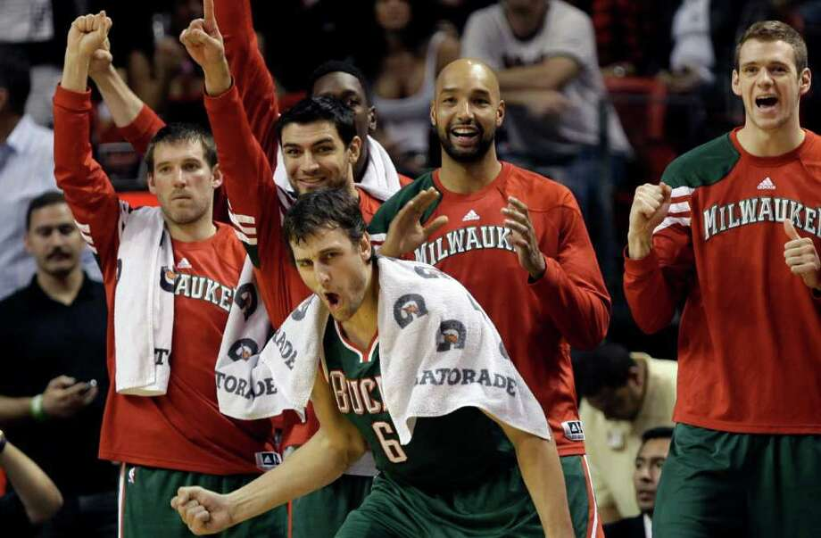 Bucks center Andrew Bogut (front) cheers on his teammates during the closing minutes of the game. Photo: AP