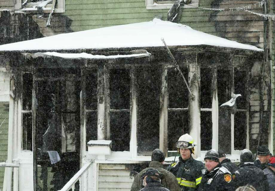 Town of Poughkeepsie and the Fairview Fire Department with other authorities at 112 Fairview Ave. in the Town of Poughkeepsie on Saturday, Jan. 21, 2012. A fire destroyed the building. (AP Photo/Poughkeepsie Journal, Darryl Bautista) Photo: Darryl Bautista, Associated Press / Associated Press