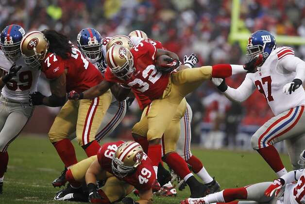49ers running back Kendall Hunter carries the ball during the first drive of Sunday's game. The San Francisco 49ers played the New York Giants in the NFC Championship game at Candlestick Park in San Francisco, Calif., on Sunday, January 22, 2012. Photo: Paul Chinn, The Chronicle