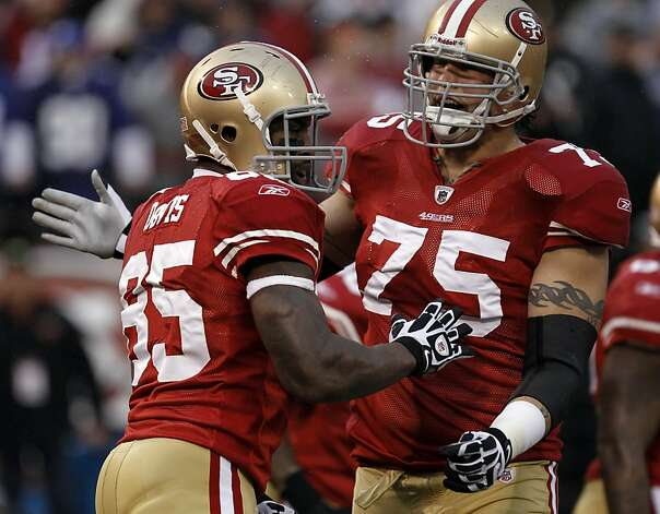 Vernon Davis celebrates his touchdown with Alex Boone in the first quarter. The San Francisco 49ers played the New York Giants in the NFC Championship game at Candlestick Park in San Francisco, Calif., on Sunday, January 22, 2012. Photo: Michael Macor, The Chronicle