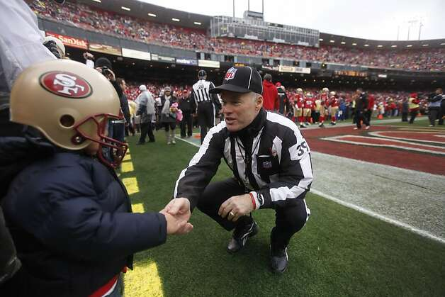 Jace Goodwin, 3, son of the 49ers' Jonathan Goodwin (#59), talks to official Don Carlsen before the start of Sunday's game. The San Francisco 49ers played the New York Giants in the NFC Championship game at Candlestick Park in San Francisco, Calif., on Sunday, January 22, 2012. Photo: Paul Chinn, The Chronicle