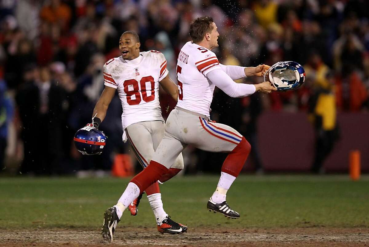 SAN FRANCISCO, CA - JANUARY 22: (L-R) Victor Cruz #80 and Steve Weatherford #5 of the New York Giants celebrate after they won 20-17 in overtime against the San Francisco 49ers during the NFC Championship Game at Candlestick Park on January 22, 2012 in San Francisco, California. (Photo by Ezra Shaw/Getty Images)