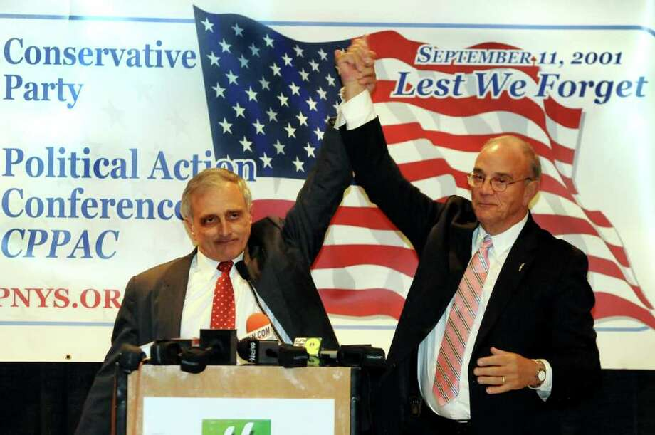Carl Paladino, left, and state chairman Michael R. Long, right, join hands as Paladino receives the nod as the Conservative Party's gubernatorial candidate on Wednesday, Sept. 29, 2010, at the Holiday Inn Turf in Colonie, N.Y. (Cindy Schultz / Times Union) Photo: Cindy Schultz / 00010450A
