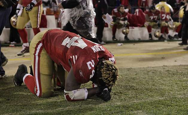 San Francisco 49ers Anthony Dixon falls to the ground after the New York Giants  defeated the 49ers 20-17,  in the  NFC Championship Game, Sunday January 22, 2012, in San Francisco,Calif. Photo: Lacy Atkins, The Chronicle