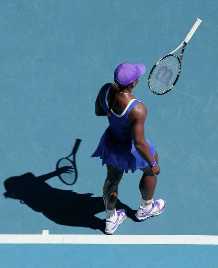 Serena Williams throws her racket in frustration during her fourth-round loss to Russia's Ekaterina Makarova. Photo: AP