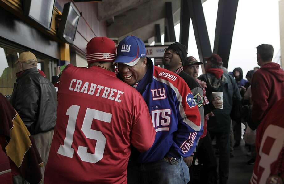 San Francisco 49er fan Adrian Cardenas, left greets Joe Luck a New York Giants fan as the start of the  NFC Championship game, Sunday January 22, 2012, in San Francisco,Calif. Photo: Lacy Atkins, The Chronicle