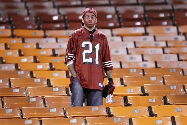 A 49ers fan watches the field after the 49ers' 20-17 overtime loss to the New York Giants. The San Francisco 49ers played the New York Giants in the NFC Championship game at Candlestick Park in San Francisco, Calif., on Sunday, January 22, 2012. Photo: Michael Macor, The Chronicle
