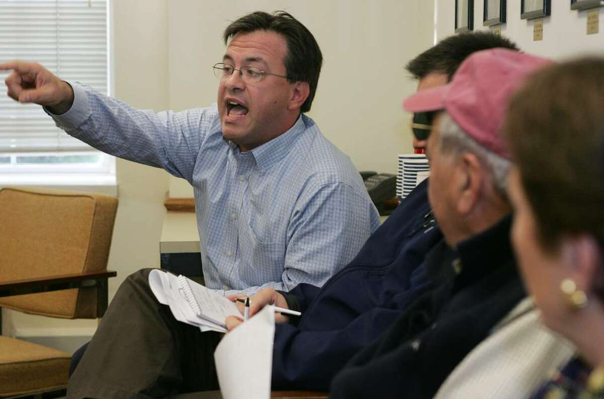 Greenwich Democratic Town Committee member Frank Farricker challenges John Craine, First Selectman's Coastal Resources Advisory Committee chairman, on accusations of cronisim in the Tesei administation.