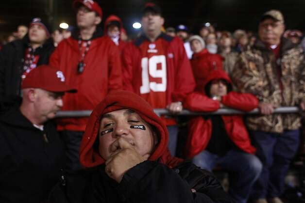 Louis Perea, of San Jose, Calif., looks down as defeat seams inevitable for the San Francisco 49ers in the final moments of overtime against the New York Giants at Candlestick Park on Sunday January 22, 2012 in San Francisco, Calif. Final score was 20-17 and Niners lost their chance to go the the Super Bowl. Photo: Mike Kepka, The Chronicle