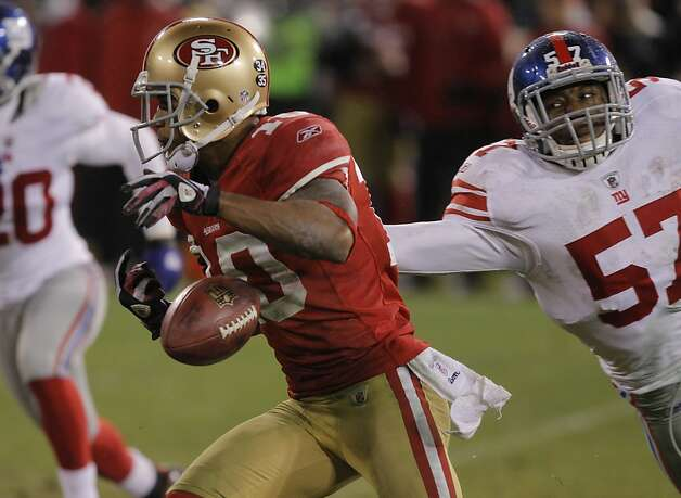 The football and the 49ers' Super Bowl hopes slip from Kyle Williams' hands during a punt return in overtime. Photo: John Storey, Special To The Chronicle