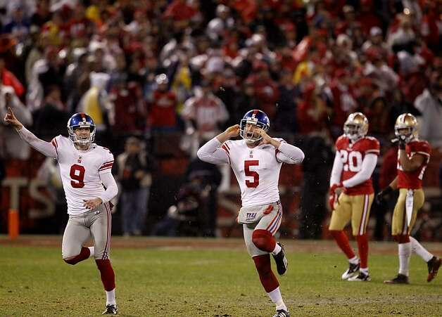 Giants field goal kicker Lawrence Tynes (9) and holder Steve Weatherford (5) reacted after the game winning field goal.  and holder San Francisco 49ers lost to the New York Giants in overtime 20-17. Photo: Brant Ward, The Chronicle