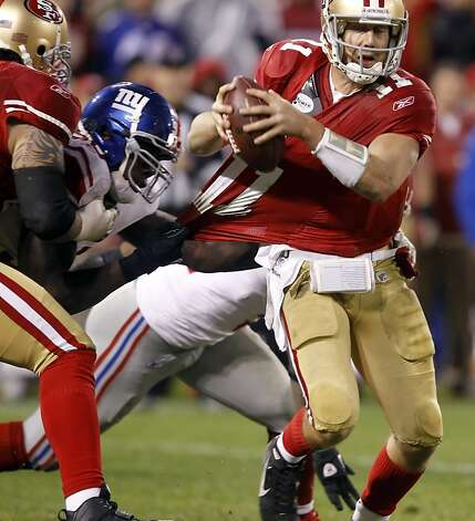 Alex Smith under pressure from Jason Pierre-Paul in the third quarter. The San Francisco 49ers played the New York Giants in the NFC Championship game at Candlestick Park in San Francisco, Calif., on Sunday, January 22, 2012. Photo: Brant Ward, The Chronicle