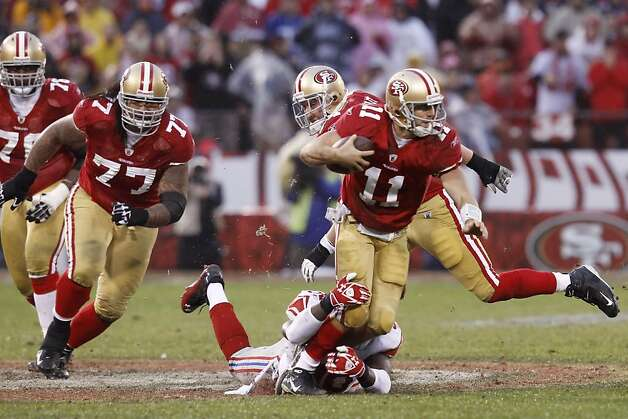 49ers quarterback Alex Smith is brought down by the Giants' Jason Pierre-Paul on a run during the second quarter of Sunday's game. The San Francisco 49ers played the New York Giants in the NFC Championship game at Candlestick Park in San Francisco, Calif., on Sunday, January 22, 2012. Photo: Brant Ward, The Chronicle