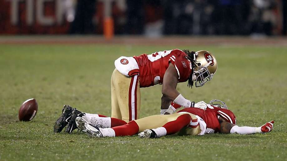 Dashon Goldson checks on Tarrell Brown after Brown was injured in the third quarter. The San Francisco 49ers played the New York Giants in the NFC Championship game at Candlestick Park in San Francisco, Calif., on Sunday, January 22, 2012. Photo: Brant Ward, The Chronicle