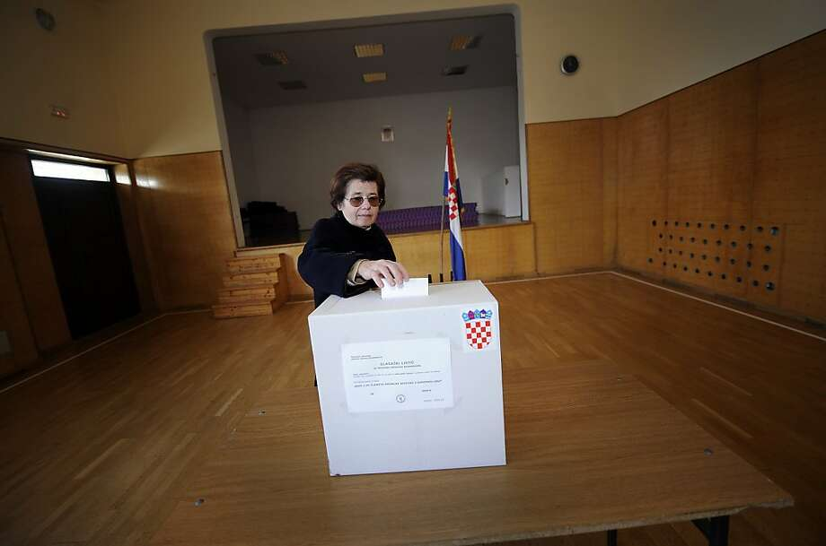 A woman casts her ballot in polling station in Donja Lomnica, some 40 kilometers from capital Zagreb, on January 22, 2012 during the referendum on EU memebership. Croatians went to the polls today in a nationwide referendum on EU membership, a vote that political leaders here see as key for the future of the Balkan country 20 years after independence. Surveys show that some 60 percent of Croatians back entry into the European Union, paving the way for the former Yugoslav republic to formally join the bloc in 2013.   AFP PHOTO/HRVOJE POLAN (Photo credit should read HRVOJE POLAN/AFP/Getty Images) Photo: Hrvoje Polan, AFP/Getty Images