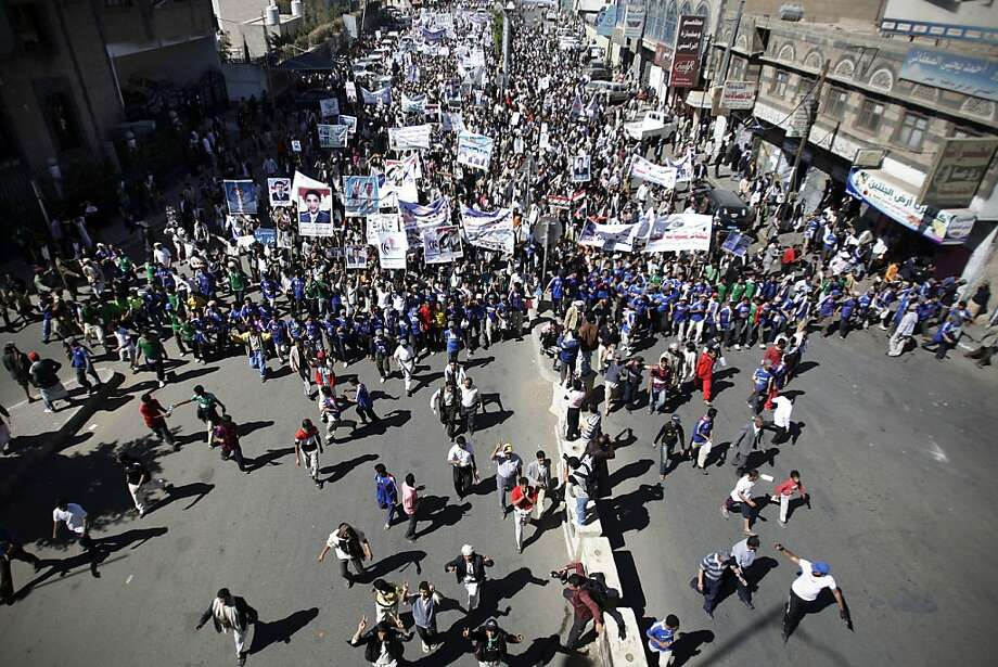 Yemeni protestors march during a demonstration denouncing the immunity law passed for Yemen's President Ali Abdullah Saleh in Sanaa, Yemen, Sunday, Jan. 22, 2012. (AP Photo/Hani Mohammed) Photo: Hani Mohammed, Associated Press