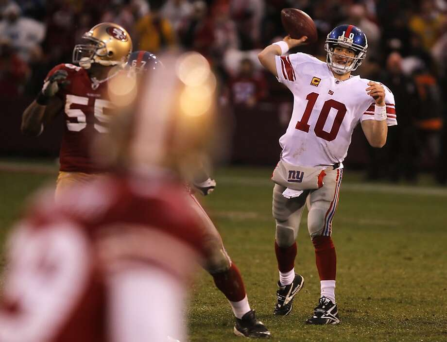 Giants quarterback Eli Manning throws during the third quarter of Sunday' game. The San Francisco 49ers played the New York Giants in the NFC Championship game at Candlestick Park in San Francisco, Calif., on Sunday, January 22, 2012. Photo: John Storey, Special To The Chronicle