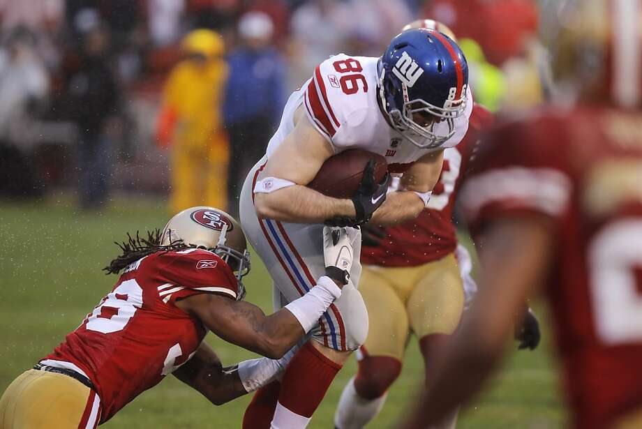 The Giants' Bear Pascoe is tackled by the 49ers' Dashon Goldson during the third quarter of Sunday's game. The San Francisco 49ers played the New York Giants in the NFC Championship game at Candlestick Park in San Francisco, Calif., on Sunday, January 22, 2012. Photo: John Storey, Special To The Chronicle
