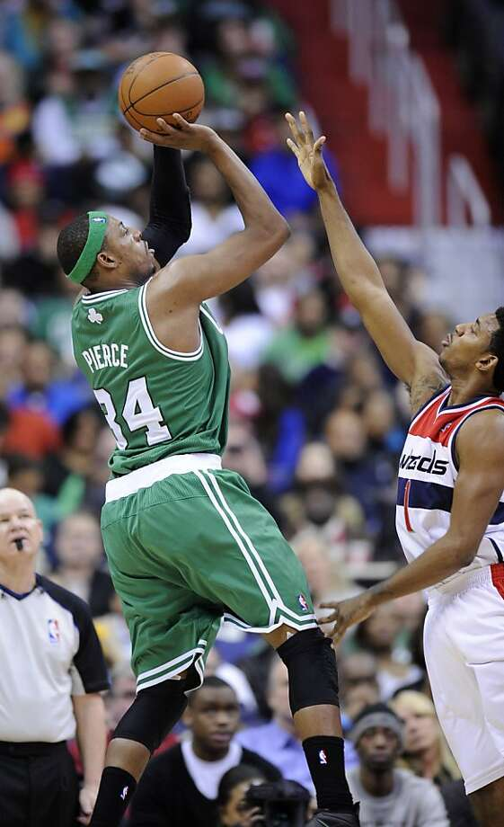 Boston Celtics forward Paul Pierce (34) takes a shot against Washington Wizards guard Nick Young (1) during the second half of an NBA basketball game on Sunday, Jan. 22, 2012, in Washington. The Celtics won 100-94. (AP Photo/Nick Wass) Photo: Nick Wass, Associated Press