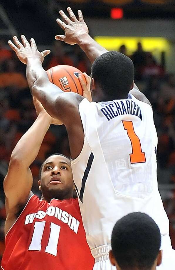 Wisconsin guard Jordan Taylor (11) shoots as Illinois' D.J. Richardson defends in the second half of an NCAA college basketball game at Assembly Hall in Champaign, Ill., on Sunday, Jan. 22, 2012. Wisconsin won 67-63. (AP Photo/Robin Scholz) Photo: Robin Scholz, Associated Press