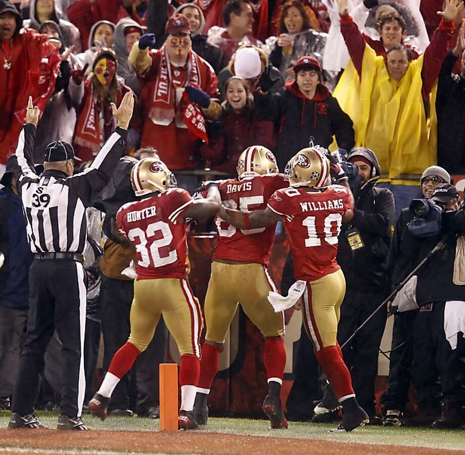 After Vernon Davis caught a 28-yard touchdown pass in the third quarter, there was reason to celebrate with Kendall Hunter, Kyle Williams and 49ers fans. The 49ers led 14-10. Photo: Brant Ward, The Chronicle