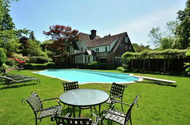 Tudor revival old world charm modern functionality for Average square footage of a swimming pool