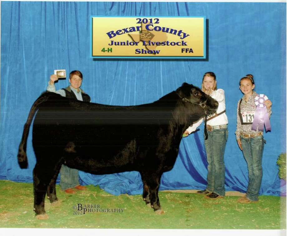 The Sedelia Grand Champion Heifer is shown by, from left, Vicki Brehm (the breeder), Lexie Ricks, and Stephanie Geistweidt. Courtesy photo Photo: Courtesy Photo