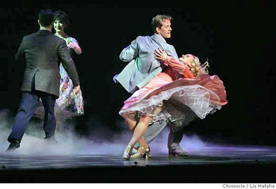 """CHRISTMAS11_133_LH.JPG Irving Berlin's """"White Christmas,"""" a new musical at the Curran Theatre. Jeffry Denman playing Phil Davis dancing with Caitlin Carter playing Rita.  � Shot on 11/5/04 in San Francisco. LIZ HAFALIA/The Chronicle MANDATORY CREDIT FOR PHOTOG AND SF CHRONICLE/ -MAGS OUT Datebook#Datebook#Chronicle#11/11/2004#ALL#Advance##0422453631 Photo: Liz Hafalia"""