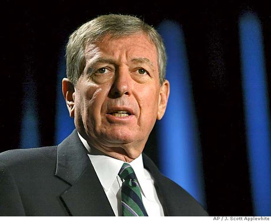 **FILE**Attorney General John Ashcroft speaks at a symposium marking the 10th anniversary of the Violence Against Women Act, at the Hilton Hotel in Washington, in this Sept. 13, 2004 file photo. Ashcroft and Commerce Secretary Don Evans resigned Tuesday, the first members of President Bush's Cabinet to leave as he headed from re-election into his second term. (AP Photo/J. Scott Applewhite) FILENY119 Nation#MainNews#Chronicle#11/10/2004#ALL#5star##0422458758 Photo: J. SCOTT APPLEWHITE