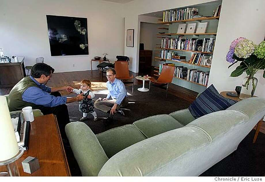 athome10_004_el.jpg  Helen, Todd Hosfelt and Louis Schump (dark hair). Story is At Home with the Style Makers -- this time Todd Hosfelt and Louis Schump and their baby daughter Helen. Todd owns the Hosfelt gallery of contemporary art downtown and Louis is an architect. They bought an ugly '70s house in Glen Park and turned it into a lovely modern open space on a very tight budget using some very clever ideas. Event on 10/27/04 in San Francisco. Eric Luse / The Chronicle MANDATORY CREDIT FOR PHOTOG AND SF CHRONICLE/ -MAGS OUT Home&Garden#Home&Garden#Chronicle#11/10/2004##Advance##0422437030 Photo: Eric Luse