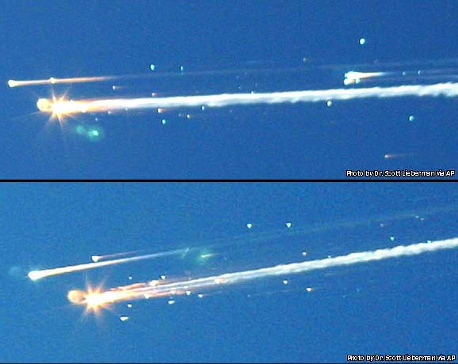 Two images by Dr. Lieberman show debris from the space shuttle Columbia streaking across the sky over Tyler, Texas, Saturday, Feb. 1, 2003. Amateur photographer Dr. Scott Lieberman shot a series of photos showing the break-up of the space shuttle from his backyard in Tyler early Saturday. Space shuttle Columbia broke apart in flames 200,000 feet over Texas on Saturday, killing all seven astronauts just minutes before they were to glide to a landing in Florida. (AP Photo/Tyler Morning Telegraph, Dr. Scott Lieberman) ** COPYRIGHT DR. SCOTT LIEBERMAN, MAGAZINES OUT, TV OUT, MANDATORY CREDIT **