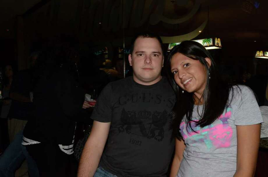 Nolan Conniff (cq) and Maria Zurita (cq) spend their Friday night at Hooligan's Bar and Grill. Robin Johnson