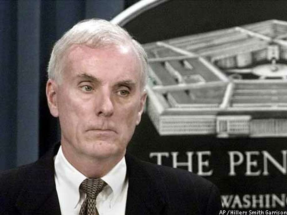 """** FILE ** Retired Navy Adm. Harold Gehman meets reporters in this Jan. 9, 2001 file photo at the Pentagon to discuss the Cole commission's report on the bombing that killed 17 sailors. NASA Administrator Sean O'Keefe said, Sunday, Feb. 2, 2003 on ABC's """"This Week"""" that Gehman will lead an independent objective board that's well versed in understanding exactly how to look about the forensics in the shuttle's destruction. (AP Photo/Hillery Smith Garrison, File) Photo: HILLERY SMITH GARRISON"""