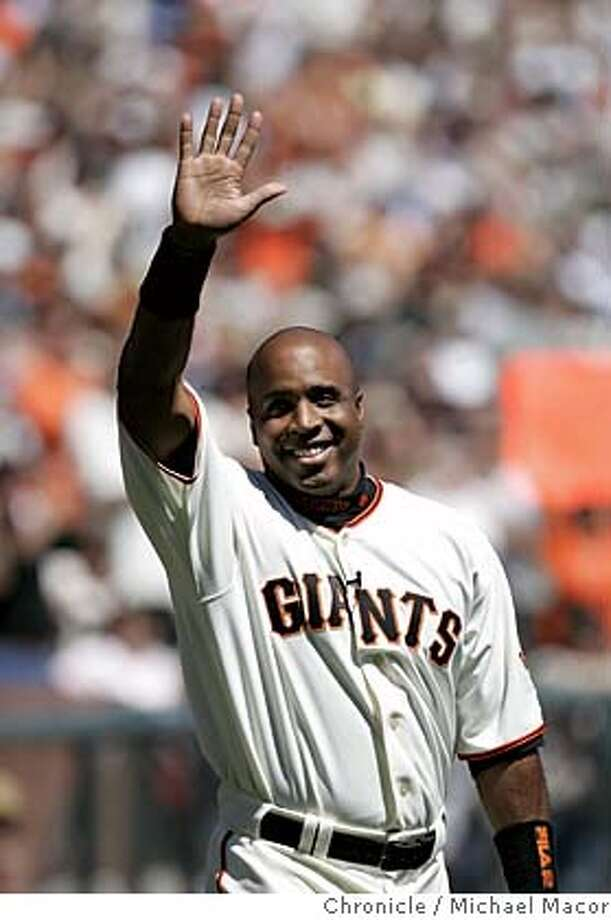 giants_025_mac.jpg Barry Bonds waves to the fans during his introdution. Opening day of the 2005 baseball season for the San Francisco Giants. The Giants take on the Los Angeles Dodgers. 4/5/05 San Francisco, Ca Michael Macor / San Francisco Chronicle Mandatory Credit for Photographer and San Francisco Chronicle/ - Magazine Out Photo: Michael Macor