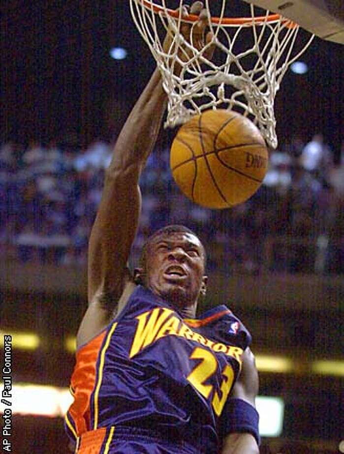 Golden State Warriors guard Jason Richardson slam dunks the basketball against the Phoenix Suns in the second quarter Saturday, Feb. 1, 2003, in Phoenix. (  AP Photo / Paul Connors Photo: PAUL CONNORS
