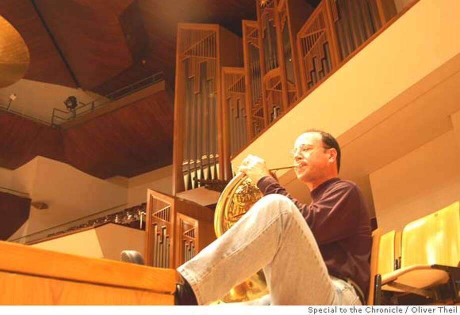 SFSYMPH2.JPG Horn player Jonathan Ring warms up in Madrid's Auditorio Nacional de Musica before the San Francisco Symphony concert. Oliver Theil/ Special To The Chronicle Datebook#Datebook#Chronicle#11/10/2004##Advance##0422456717
