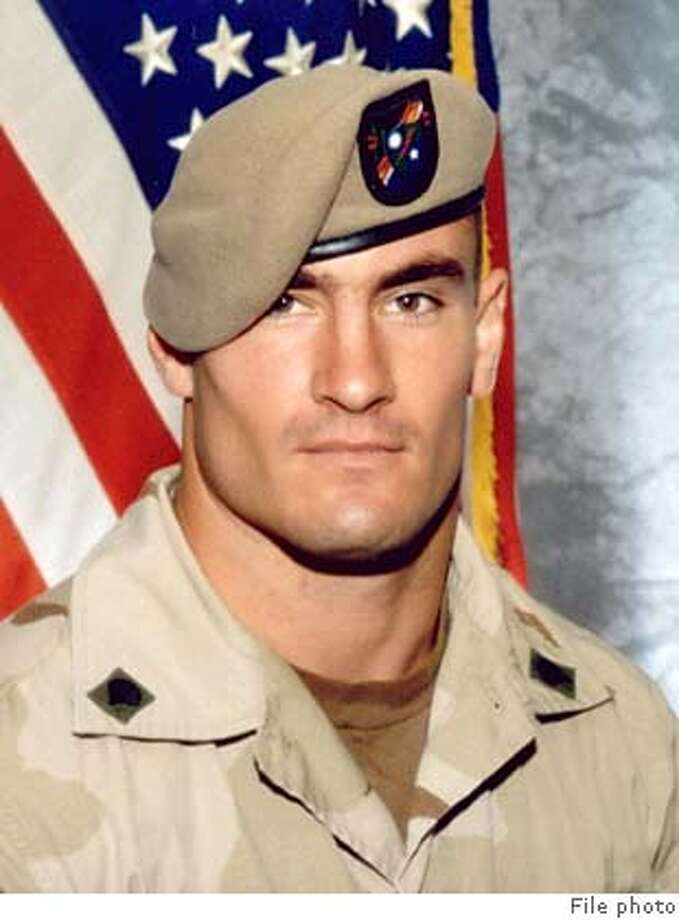 "The U.S. Army has opened a new investigation into the circumstances of the April death in Afghanistan of Cpl. Pat Tillman, a former professional football player killed in a ""probable"" friendly fire incident, officials said on December 6, 2004. The investigation was ordered on November 3 by then-acting Army Secretary Les Brownlee and was prompted by questions raised by Tillman's family about his death in a remote canyon in southeastern Afghanistan, Army officials said. One official said the investigation could trigger criminal charges if any U.S. personnel are deemed culpable in his death. Tillman is pictured in this June 2003 file photograph. FOR EDITORIAL USE ONLY REUTERS/Photography Plus C/O Stealth Media Solutions/Handout Ran on: 12-07-2004  Pat Tillman Ran on: 12-26-2004  President Bush on the war: &quo;I sent American troops to Iraq to make its people free, not to make them American.&quo; 0 Photo: HO"