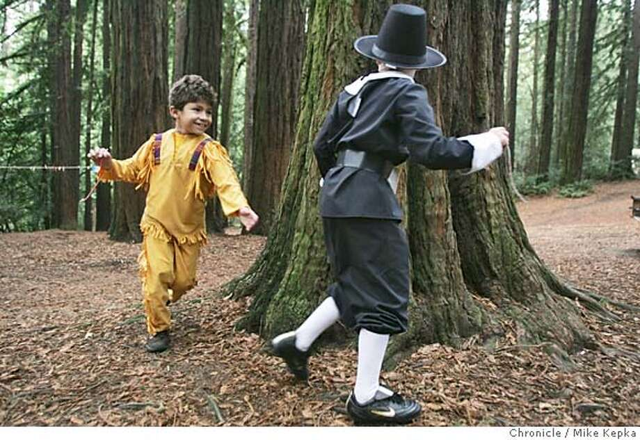 pilgrim100009_mk.jpg  In the crafts area, Travis Lynds, 7, and Matthew Ferreira, 7, walk around a tree waiting for their freshly dipped candles to cool before the next coat of wax.  In Oakland at Roberts Park, 47 second graders from Joaquin Miller School and their parents and teacher participate in the schools 27th annual thanksgiving living history day where student wear an interpretation of Mayflower era clothing and participate in activities people from that time might have done during this time. 11/8/04  MIKE KEPKA/The Chronicle MANADATORY CREDIT FOR PHOTOG AND SF CHRONICLE/ -MAGS OUT Metro#Metro#Chronicle#11/10/2004#ALL#5star##0422458897 Photo: MIKE KEPKA