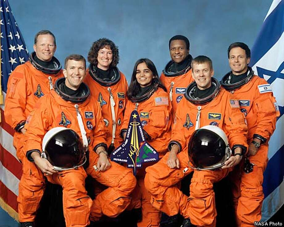 FILE -- (NYT6) UNDATED -- Feb. 2, 2003 -- Space Shuttle Columbia crew from left, front row: Rick Husband, Kalpana Chawla, William McCool. Back row, David Brown, Laurel Clark, Michael Anderson and Israeli astronaut Ilan Ramon. NASA lost communication with space shuttle Columbia as the ship soared over Texas several minutes before landing Saturday morning Feb. 1, 2002. NASA Photo Photo: NASA