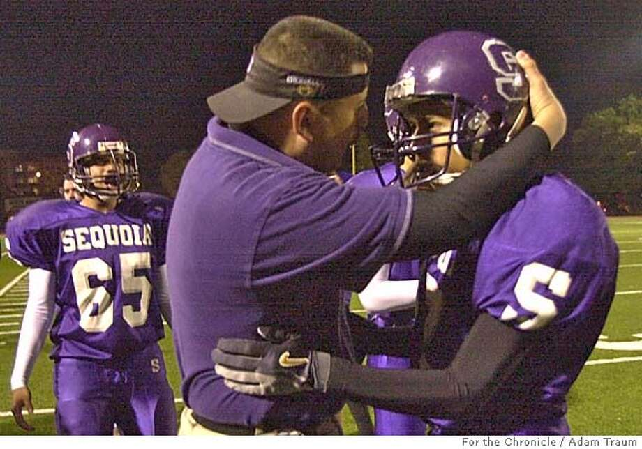 Sequoia High School Coach Leo Garcia, left, excited about Lonnie Brown's 4th quarter touchdown against El Camino. The team got back into the game, but didn't win their homecoming game. Schools with football traditions like Sequoia High School in Redwood City have had come on hard times. In spite of the difficulties the team faces the they continue to support each other. Photo by Adam Traum/San Francisco Chronicle Photo: Adam Traum