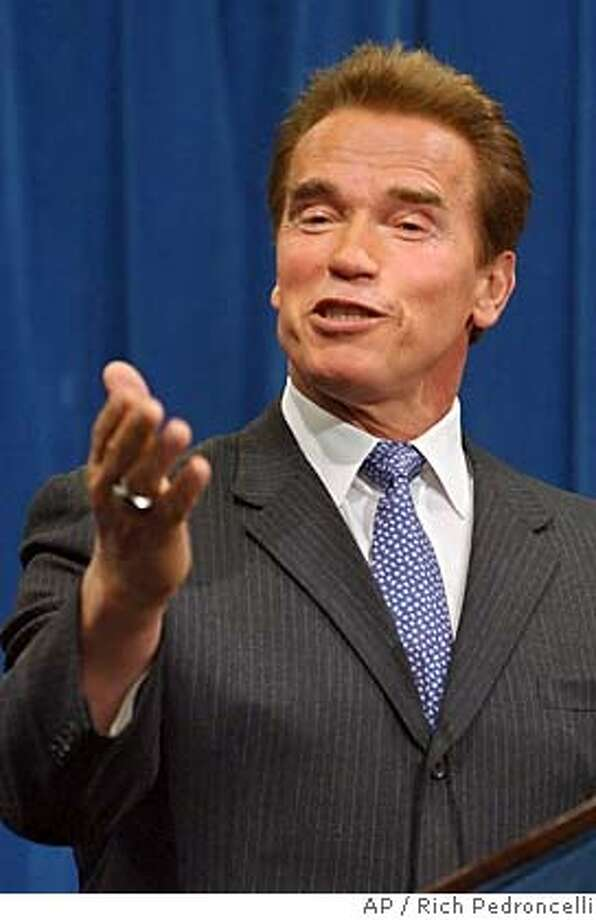 Gov. Arnold Schwarzenegger answers questions concerning the outcome of Tuesday's elections during a Capitol news conference in Sacramento, Calif., Wednesday, Nov. 3, 2004. Despite having California voters reject 12 of the16 GOP legislative candidates backed by Schwarzenegger, they also delivered the governor victories on all but four of the 15 ballot measures that he targeted in his campaign efforts. (AP Photo/Rich Pedroncelli) Metro#Metro#Chronicle#11/9/2004#ALL#5star##0422450026 Photo: RICH PEDRONCELLI